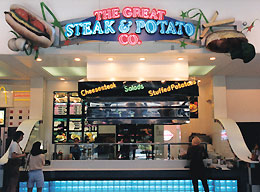restaurant storefront with steak, potato and french fries