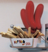 sculptures of hotdogs on sticks and french fries
